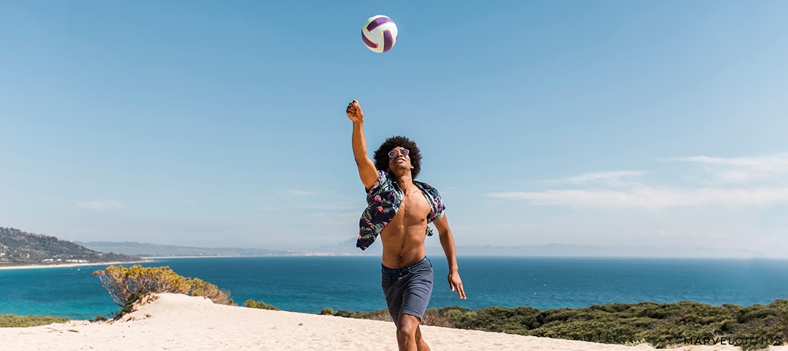 man wearing sunglasses playing volleyball