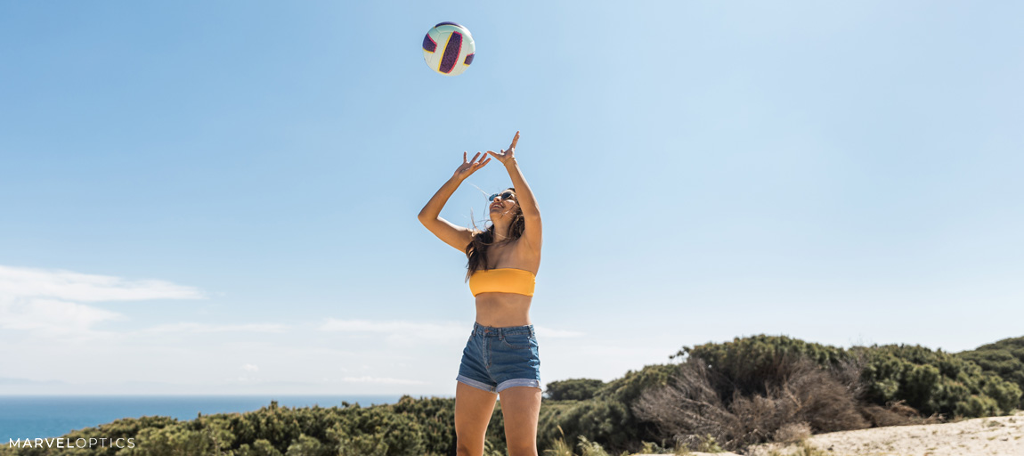 woman with sunglasses playing volleyball