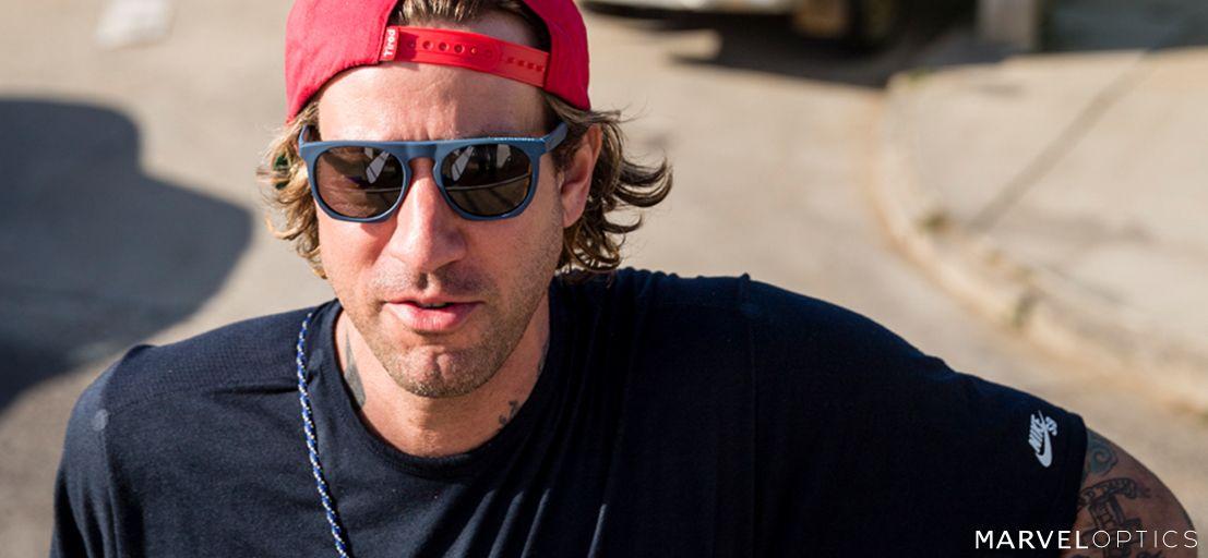 man running with Nike sunglasses