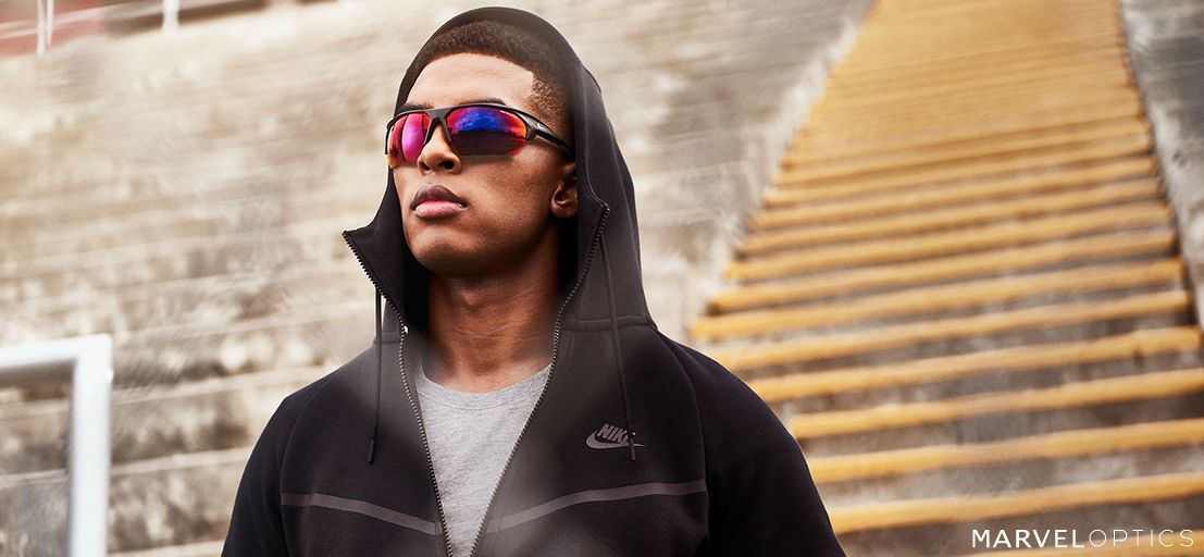 man with a hood wearing Men's Sunglasses by Nike